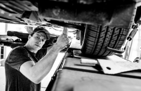 Car Service Mechanic Doing Car's Tire Service